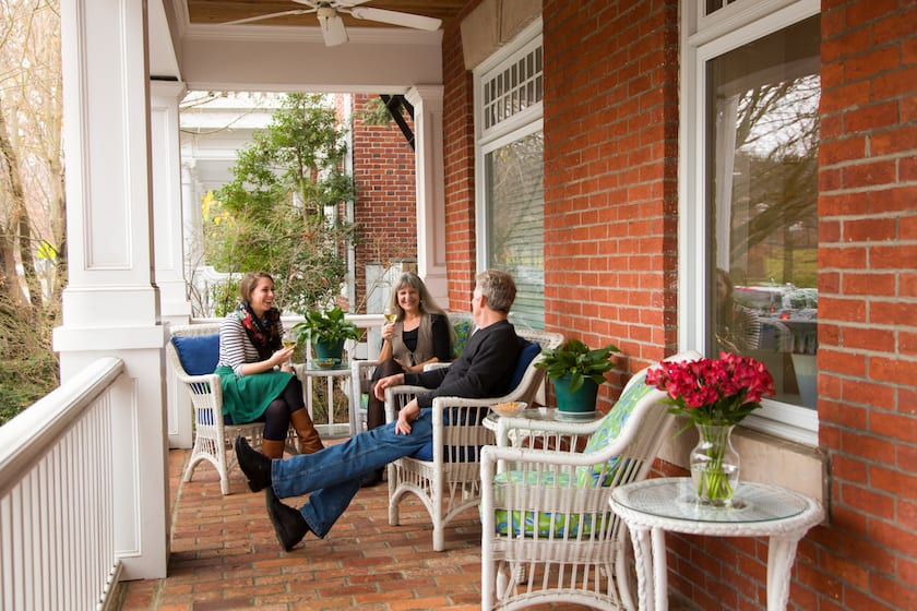 Guests enjoying glasses of wine on the front porch of Woodley Park Guest House in DC