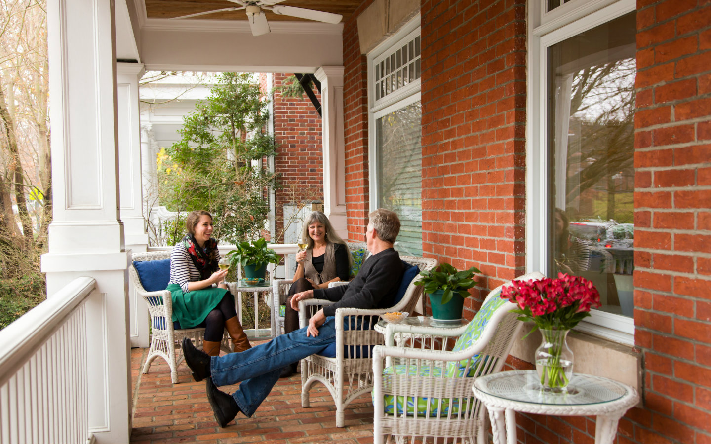 People chatting on a lovely front porch