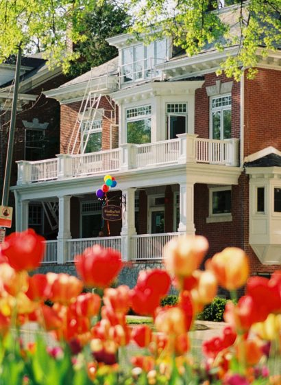 Colorful tulips bloom in front of the Woodley Park Guest House