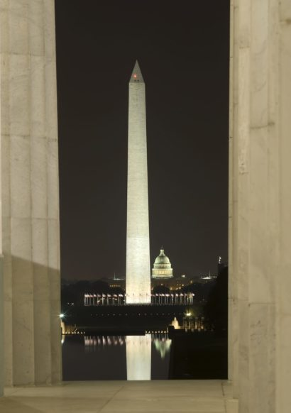 The Washington Monument is lit up at night